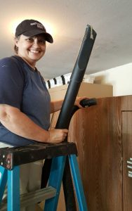 Rhonda Cannady helps to clean and organize the garage